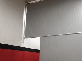 2 MOTOR; WALL GUIDED CENTER-ROLL CURTAIN